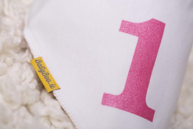 Pink first birthday babyboo bandana bib