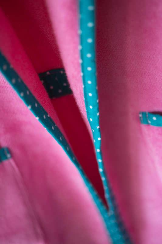 Pink with teal stars organic cotton robe - piping detail
