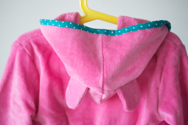 Pink with teal stars organic cotton robe - hood detail