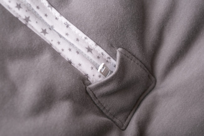 Zip detail grey sleeping bag