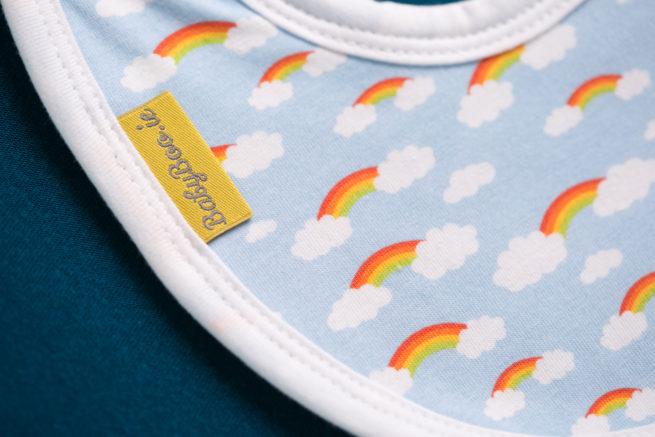 rainbows and clouds newborn bib