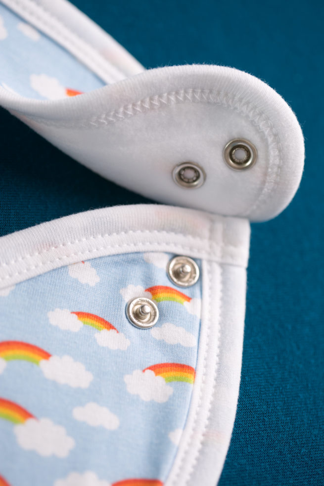 rainbows and clouds newborn bib