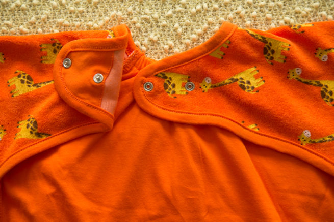 Orange giraffes yummyboo feeding bib