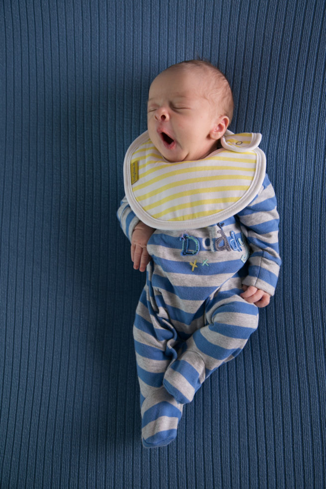 Newborn baby wearing LittleBoo bib